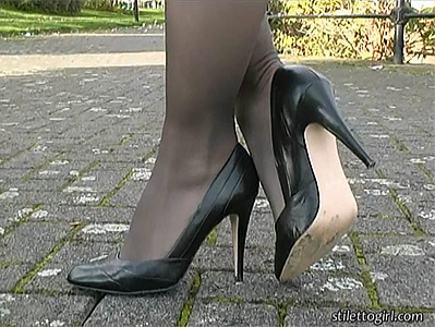 Sexy pantyhose and high heel in the park