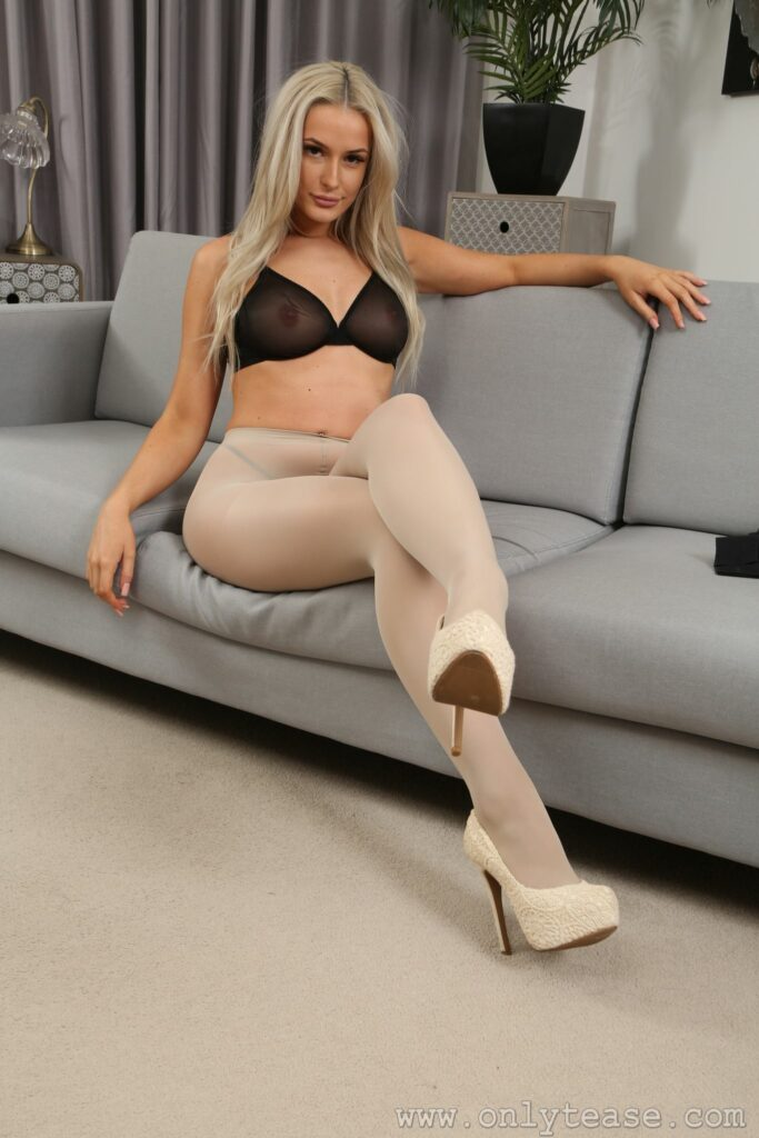 Paige F from Only Tease in a miniskirt with high heels and opaque pantyhose