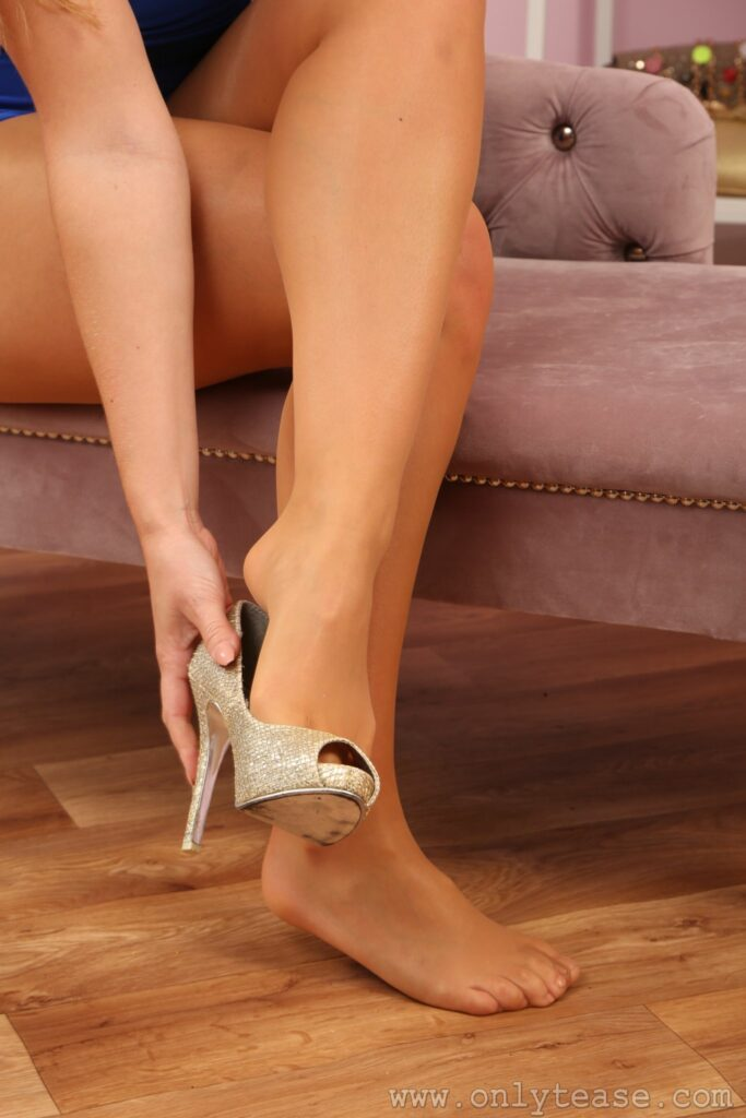 Lucy Ava from Only Tease in a blue minidress with high heels and pantyhose